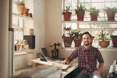 Designer sitting in his comfortable and welcoming office space Stock Photography