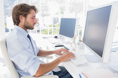 Designer sitting at his desk and working Royalty Free Stock Photos