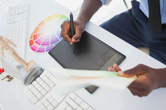 Designer sitting at his desk working with digitizer Royalty Free Stock Photo