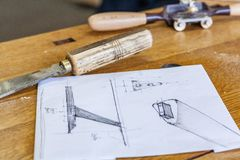 Designer sketches. Woodworking lifestyle, organic eco friendly design elements. Eco-friendly woodworker`s shop. Details and focus on the texture of the material royalty free stock photo