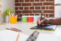 Designer sketching on graphics tablet Royalty Free Stock Image
