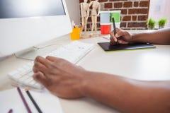 Designer sketching on graphics tablet Stock Images