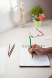 Designer sketching on paper with pencil Stock Image