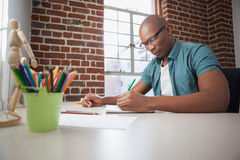Designer sketching on paper with pencil Royalty Free Stock Photo