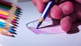 Designer smooth strokes complements blue pencil sketch. Close up. Slow motion stock video