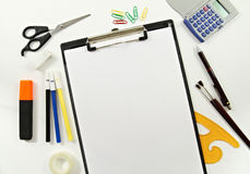 Designer and Stationery Materials. Various designer and stationery materials like ruler, scissors, pens, brushes and a4 blank paper on white desk Stock Image
