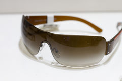 Designer sunglasses on display. Designer sunglasses on a white background on display in a store shelf Stock Photo