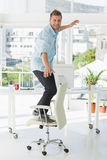 Designer surfing on his office chair Royalty Free Stock Photos