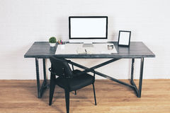 Designer table with black chair Royalty Free Stock Image