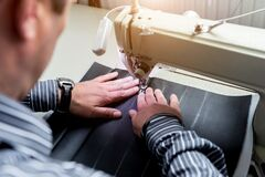 Free Designer Tailor Sew Seat Covers. Man Use Sewing Machine For His Work. Royalty Free Stock Image - 194287436
