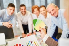Designer team in workshop. Creative designer team in workshop with color palette royalty free stock photo