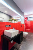 Designer toilet with red tiles Royalty Free Stock Photos