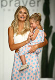 Designer Tori Praver and her daughter walks runway during the Tori Praver Swimwear fashion show. MIAMI, FL - JULY 18: Designer Tori Praver and her daughter walks Stock Images