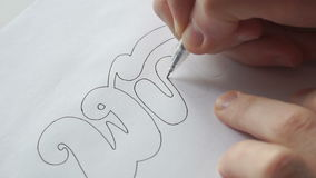 Designer trace the letters with pen stock video