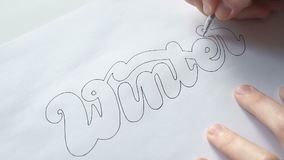 Designer trace the letters with pen stock video footage