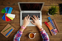 Designer typing Stock Photos