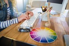 Designer typing on keyboard Stock Image