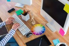 Designer typing on keyboard Stock Images