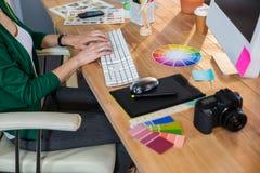 Designer typing on keyboard Stock Photo
