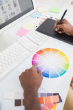 Designer using colour wheel and digitizer Royalty Free Stock Photos
