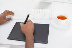 Designer using computer and digitizer with tea Stock Photography