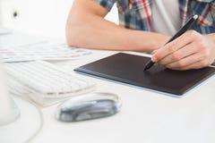 Designer using digitizer at desk Royalty Free Stock Images