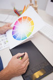 Designer using graphics tablet and colour wheel Stock Photography
