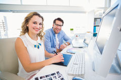 Designer using a graphics tablet while looking at camera Royalty Free Stock Image