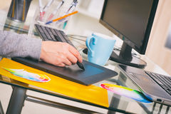 Designer using graphics tablet. In the office Stock Photo