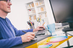 Designer using graphics tablet. In the office Royalty Free Stock Images