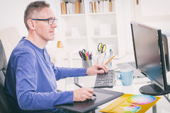 Designer using graphics tablet. In the office Stock Photos