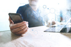Designer using smart phone and keyboard dock digital tablet.Worl. Designer using smart phone and keyboard dock digital tablet with laptop.Worldwide network Royalty Free Stock Photography
