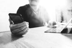 Designer using smart phone and keyboard dock digital tablet.Worl Stock Images