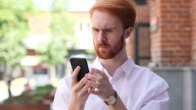Designer Using Smartphone while standing Outside. Designer Using Smartphone while Sitting Outside Office, Browsing Online,4k , high quality stock video