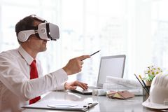 Designer visualizing 3d content in virtual reality glasses. In the office. Horizontal composition Stock Image