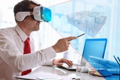 Designer visualizing 3d plane in virtual reality glasses in the. Office. Horizontal composition royalty free stock photography