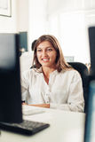 Designer woman using computer in the office Stock Photography