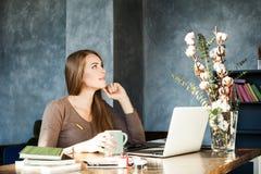 Designer Woman Working in Studio. Girl working Royalty Free Stock Images