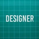 Designer word on cutting mat Stock Photos