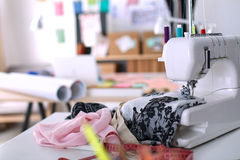 Designer work place sewing machine in office Stock Photography
