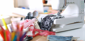 Designer work place sewing machine in office Stock Images