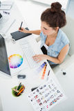 Designer working with colour wheel and digitizer Stock Image