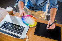 Designer working with colour wheel and digitizer Royalty Free Stock Photography