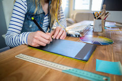 Designer working with colour wheel and digitizer Stock Photos