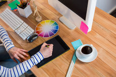 Designer working with colour wheel and digitizer Royalty Free Stock Photo