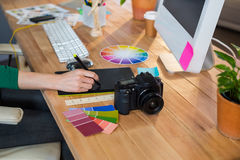 Designer working with colour wheel and digitizer royalty free stock images