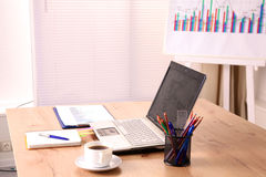 Designer working desk with a computer and paperwork Stock Photography
