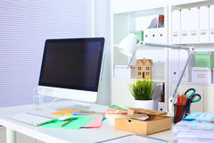 Designer working desk with computer and paperwork Stock Image