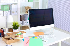 Designer working desk with a computer and paperwork Royalty Free Stock Images