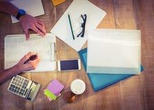 Designer working at desk overhead shot Stock Photo